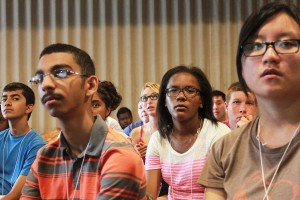 Delegates listen attentively